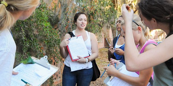 Students gather for an outdoor plant identification and use lab