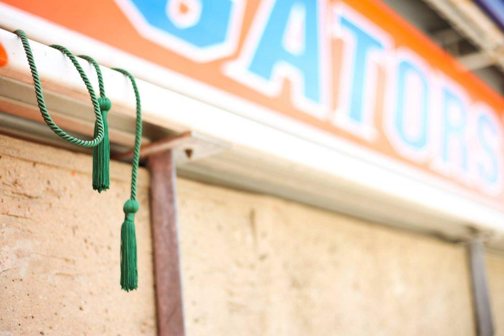 Gator green cord balanced on stadium seat