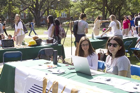 Students tabling on campus lawn