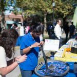 Student Organization helps inflate tires at Sustainable Transportation Fair