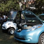 Electric cars parked with their hoods open at the Sustainable Transportation Fair