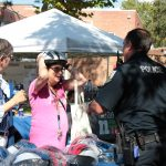 Police hand out helmets at the Sustainable Transportation Fair
