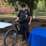 Police poses with their bicycle