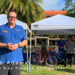 Jacob Adams, Campus Bike Program Coordinator, stands in front of his stand at the Sustainable Transportation Fair